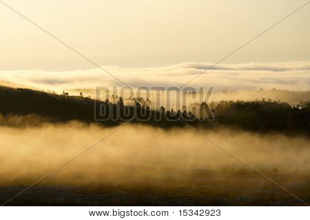 Sunset in the foggy mountains