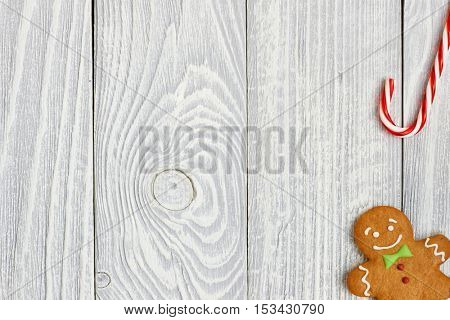 Christmas homemade gingerbread cookie and decoration on wooden background