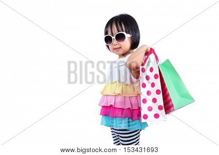 Happy Asian Chinese Little Girl Holding Shopping Bags