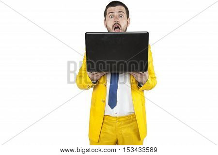 Frightened Face Of A Businessman Sticking Out From Behind The Computer