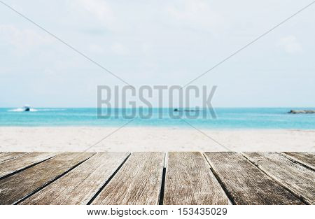 The Beach in Summer, wooden terrace with defocused tropical beach
