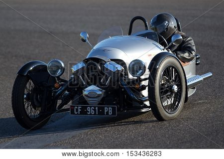 NOGARO, FRANCE - OCTOBER 9: A very strange old bright grey car is moving fast on a circuit during the Classic Festival, on october 9, 2016, in Nogaro, France.