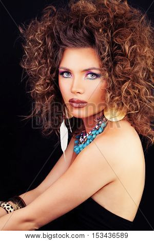Beautiful Woman Fashion Model with Curly Hair Make-up and Accessories in the Ethnic style
