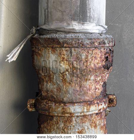 Closeup of an old rusty metal drainpipe