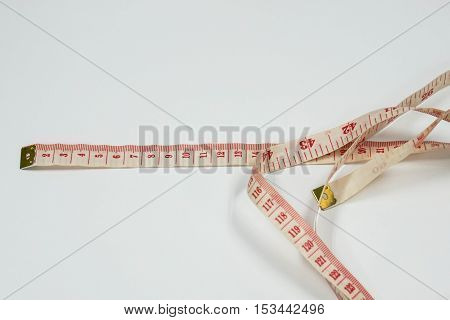close up isolate plastic tape measure on table