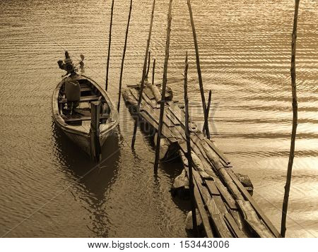The Old wooden boat at wharf Retro style