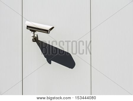 Security camera is mounted on a wall.