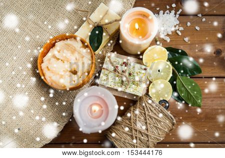 beauty, spa, therapy, natural cosmetics and wellness concept - body care cosmetic products on wood over snow