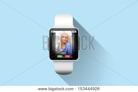 modern technology, communication, object and media concept - close up of black smart watch with incoming call on screen over blue background