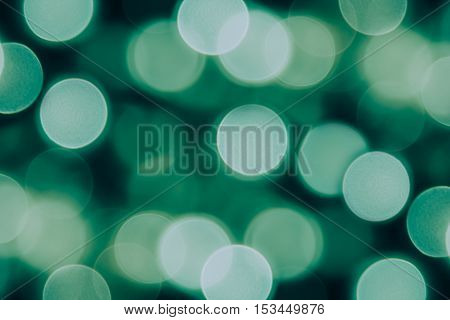 Bokeh dark green circles on black background. Abstract music background.