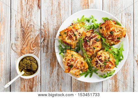 Chicken Breast On White Dish With Fresh Arugula