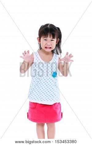Angry girl growls funny emotional. Lovely asian girl frighten somebody hands are menacingly lifted and mouth grin. Trick or treat concept for halloween background. Isolated on white background.