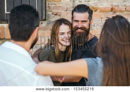 Smilling Couple With Friends