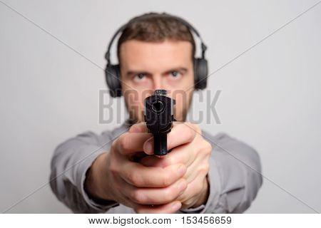 Man Holding A Gun In His Hand Ready To Shot