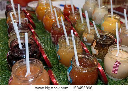 Multiple Jars With Fruity Jam And Teaspoon