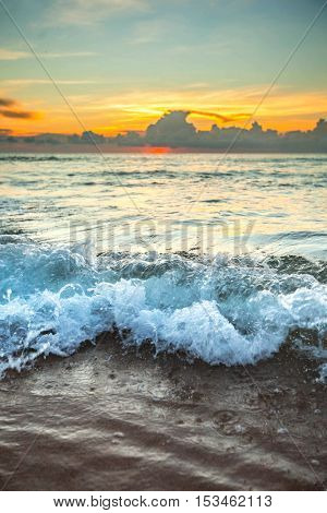 Beautiful sunset with orange sky over tropical sea