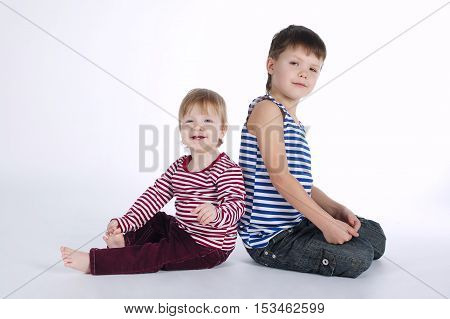 photo of two funny siblings portraits on white background