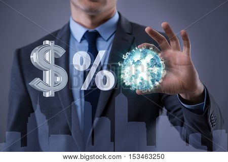 Businessman with various currencies in business concept
