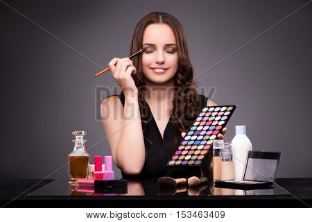 Young beautiful woman during make-up session