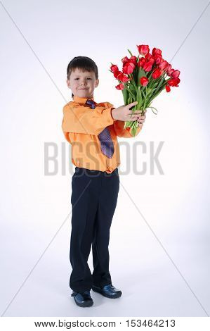 photo of beautiful boy with big bouquet of tulips