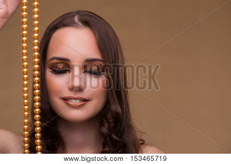 Young beautiful woman with pearl necklace