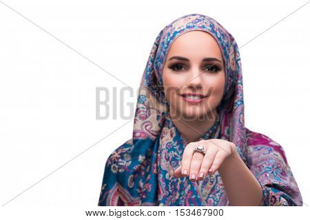 Woman in traditional muslim cover with ring