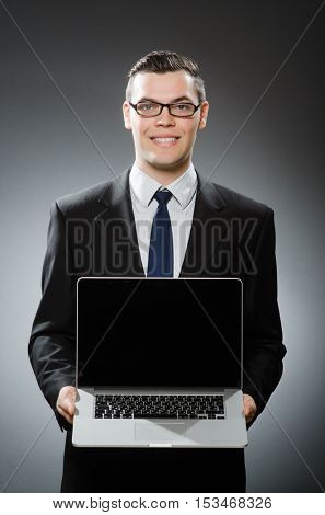 Man with laptop in business concept