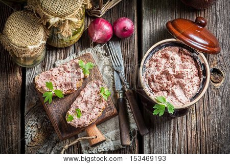Delicious sandwich with pate and parsley on old wooden table