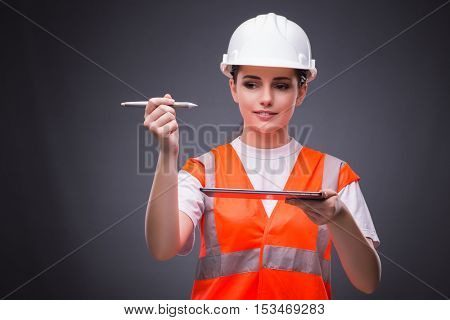 Young construction worker with tablet computer