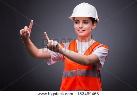 Cute construction worker pressing virtual buttons