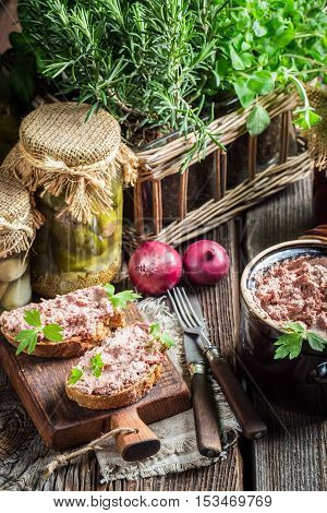 Tasty sandwich with pate and parsley on old wooden table