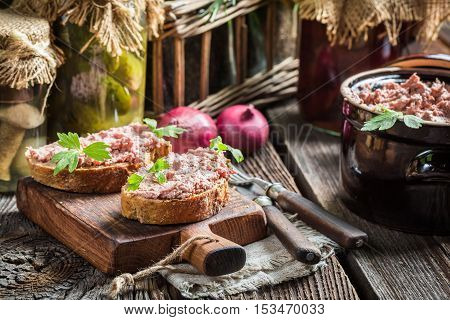 Sandwich with homemade pate on old wooden table
