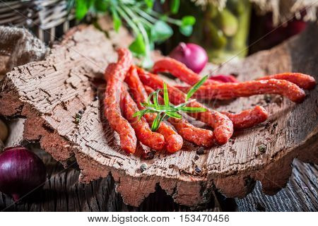 Closeup Of Tasty Homemade Thin Sausages On Bark