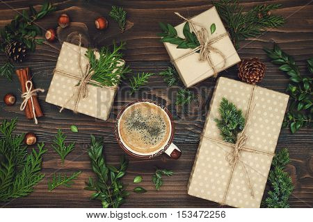 Decorated gift boxes presents on rustic wooden table. Ideal Christmas morning breakfast. Overhead flat lay top view
