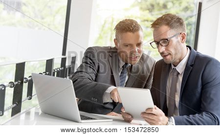 Two Businessmen Cafe Meeting Wireless Tablet Concept