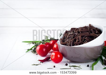 Italian Food Background With Pene, Vine Tomatoes, Spaghetti, Garlic