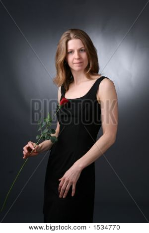 Woman With Rose In Black Dress