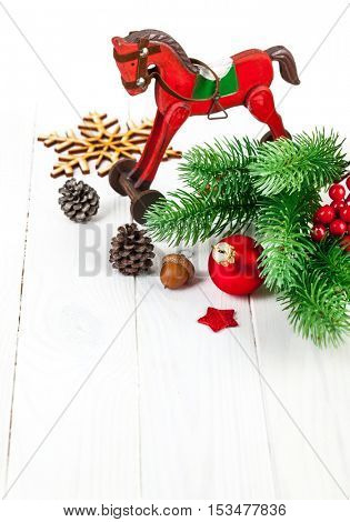 Christmas decoration with fir and pinecone on white wooden board copyspace