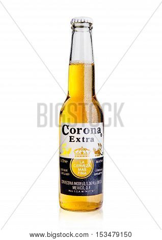 LONDON UNITED KINGDOM - October 23 2016: Bottle of Corona Extra Beer on white. Corona produced by Grupo Modelo with Anheuser Busch InBev is the most popular imported beer in the US.