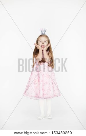 Full body portrait of cute little girl child with blond hair and pink dress isolated on white background