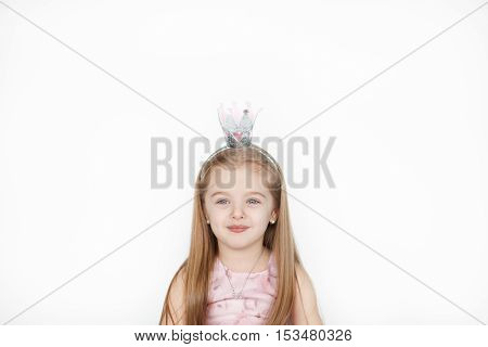 Thinking princess concept. Beautiful little girl wearing fairy costume with crown dreaming about something. Copy space above the head for text