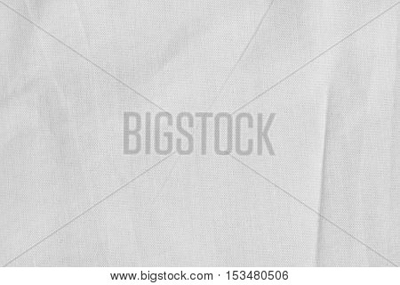 White canvas with delicate striped pattern crumpled. Fabric texture background.
