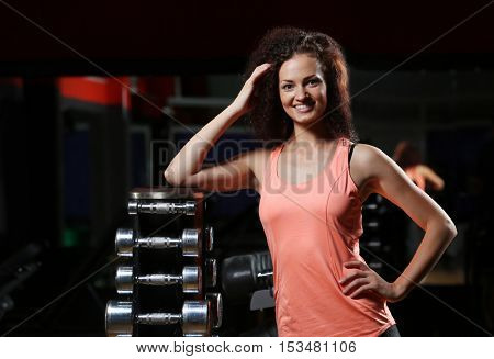 Portrait of young sportive woman in gym