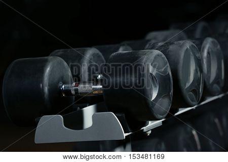 Set of dumbbells in gym