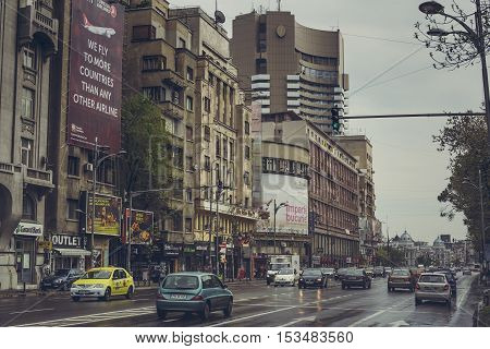 Bucharest Romania - April 22 2014: Rush hour on a rainy day on Magheru Boulevard a major avenue in central Bucharest and the most expensive commercial street in the Romania.
