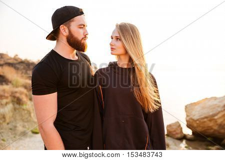 Fitness sport running couple resting after exercise workout and looking at each other