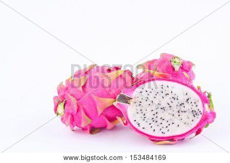 sliced  raw organic dragon fruit (dragonfruit) or pitaya on white background healthy fruit food isolated