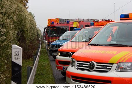 HANNOVER / GERMANY - OCTOBER 25 2016: german emergency service cars stands in a row on freeway a2 by a truck crash near Hannover.