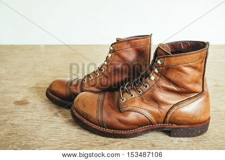 vintage style picture with safety boots and Industrial boots for construction