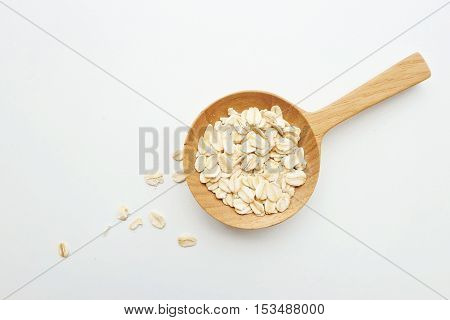 A spoonful of oats and white background